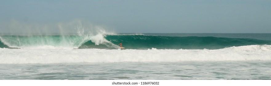 Surfer in the Pipeline of Puerto Escondido, Mexico