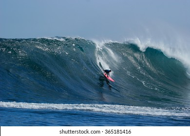 A surfer rides a huge wave at Dungeons in Cape Town, South Africa.