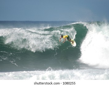 Surfer rides a wave at Bonzai Pipeline off of Oahu's North Shore.