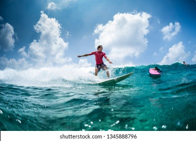 Surfer rides the wave at sunny day