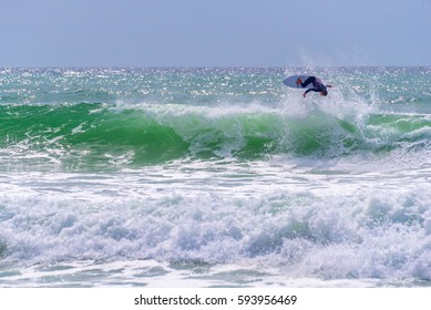 Surfer riding a huge wave during  World surf league competition in Lacanau, France