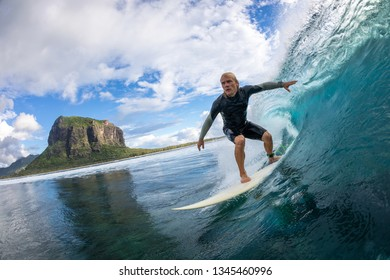 surfer riding on big waves on the Indian Ocean island of Mauritius