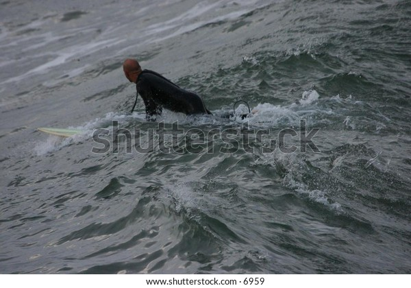 surfer riding the waves