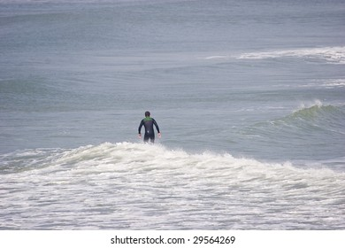surfer in the sea in brittany