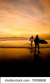 Surfer Silhouettes at Sunset