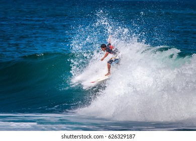 The surfer slides on the crest of the wave. Surfing in the Pacific Ocean. Training surfers. Ecuador. The village of Montanita. 03,05,2006year