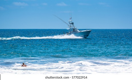 Surfer and sport fishermen. Costa Rica, a paradise for surfing and sport fishing