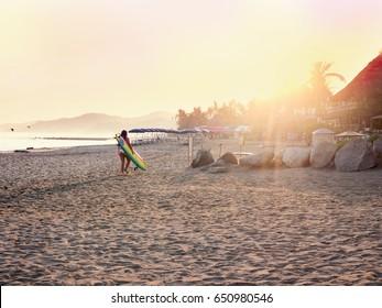 Surfer at sunrise. Sayulita Mexico