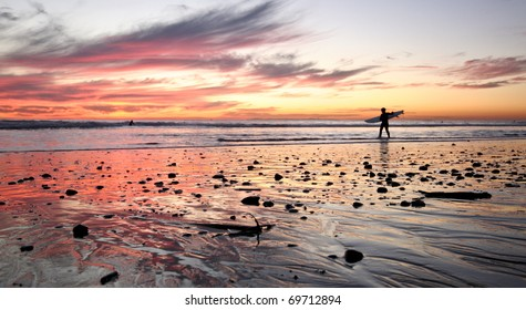 Surfer at sunset