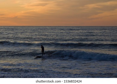 Surfer at Sunset in California