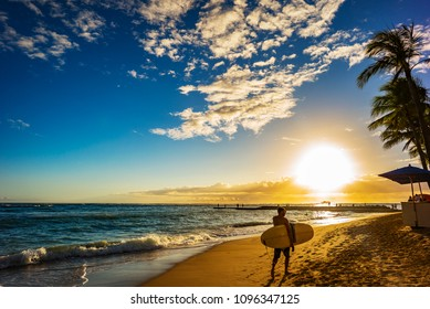 Surfer At Sunset On Waikiki Beach, Hawaii, Oahu, Honolulu