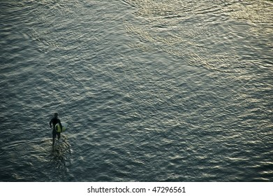 Surfer and the surface of the sea. Bali. Indonesia.