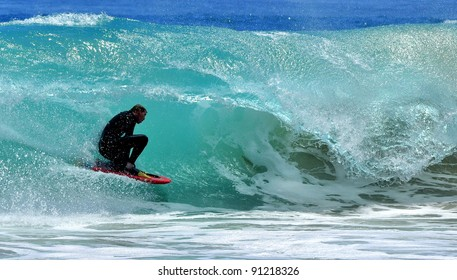 Surfer surfing wave off the coast of Western Australia