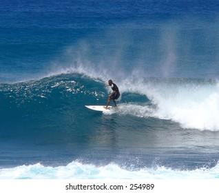 Surfer takes the right break on Maui's north shore.