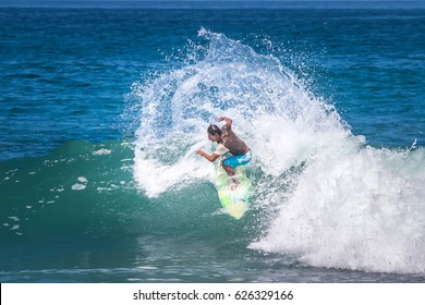 Surfer. Turn on the wave with large sprays. Training surfers. Ecuador. The village of Montanita. 03,05,2006year