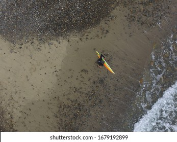 Surfer waiting for wave in ocean, Aerial drone photo