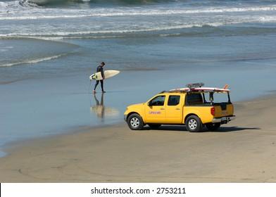 Surfer Walks Beach in Southern California