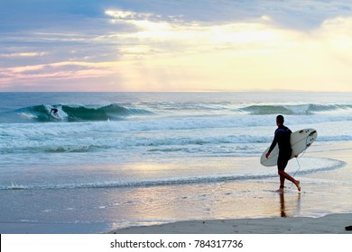 Surfer watching surfer.