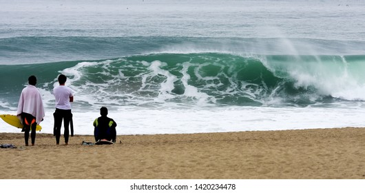 Surfer watching onto the waves