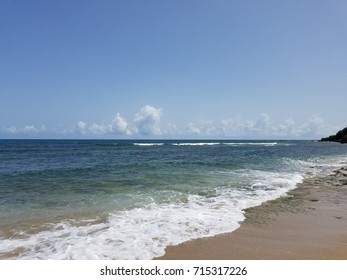 a surfer and waves on beach in Puerto Rico