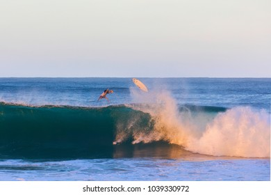 Surfer wiping out over a big waves