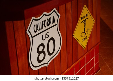 Surfer xing yellow sign and California route sign