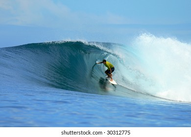 Surfer in yellow t-shirt in barrel, Mentawai Islands, Indonesia