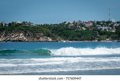 Surfers and Beach in Puerto Escondido Playa Zicatela, Mexico