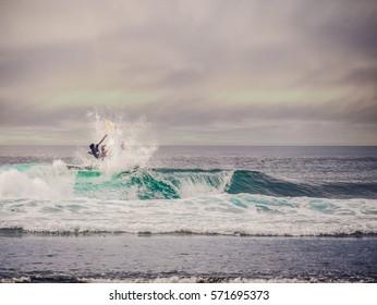 Surfers big jump / Bali surfers