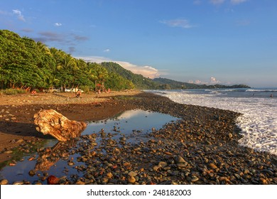 A surfer's destination, Playa Dominical in Costa Rica is a rocky beach settled mostly by foreign surfers.