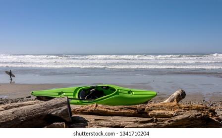 Surfers enjoying the waves on the Oregon coast.