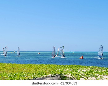Surfers, Micro Beach, Saipan Micro Beach is one of the favorite surfing destinations in the Northern Mariana Islands.