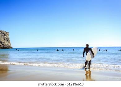 Surfers on Beliche Beach, Mediterranean Sea, Portugal