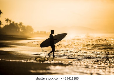 Surfers on an ocean beach.