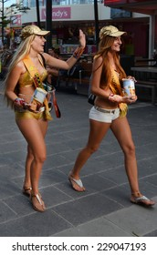 SURFERS PARADISE, AUS - OCT 26 2014:Meter maids walking down Cavill Avenue.They feed the meter to buy more time for motorists that overstay as a goodwill and promote Surfers Paradise for tourism.