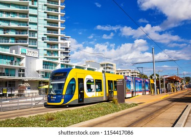 SURFERS PARADISE, AUSTRALIA - AUGUST 10,2018: A tram on the G:Link light rail system awaits departure from Broadwater Parklands station.