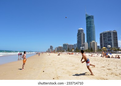 SURFERS PARADISE - NOV 08 2014:Visitors play on main beach in Surfers Paradise.It one of Australia's iconic coastal tourist destinations, drawing 10 million tourists every year from all over the world