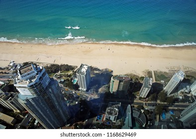 SURFERS PARADISE, QUEENSLAND, AUSTRALIA - 17 AUGUST 2018: Aerial view from Q1 lookout looking down on the high rise buildings of Surfers, the famous beach and emerald green waters of the Pacific.
