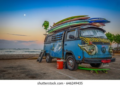 SURFER'S PEACE BUS, MAY 2017; Hawaiian surfer's Volkswagen bus with colorful paint scheme and boards with a morning sunrise.