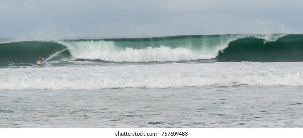 Surfers at Playa Zicatela in Oaxaca Mexico