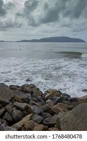 surfers in the Santos Sea, submarine emissary