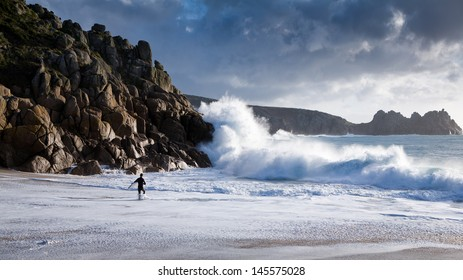 Surfers in the sea at Porthcurno, Cornwall.