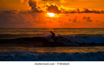 Surfers in the sunset. Costa Rica, surfing paradise