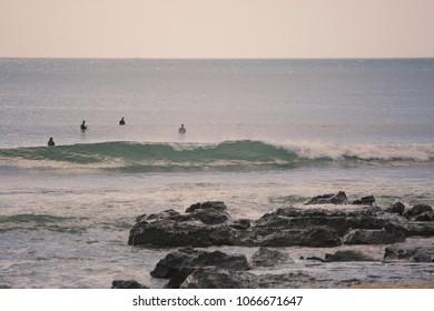 Surfers at Supertubes, Jeffreys bay
