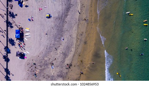 Surfers and surfboards from above in La Jolla, California