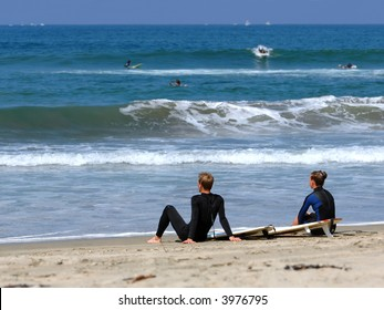 Surfers Take A Break In Southern California