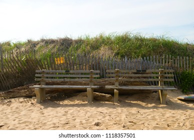 "surfer's ""The Bench"" on Ditch Plains Beach Montauk, New York, The Hamptons with erosion control sign on dunes"