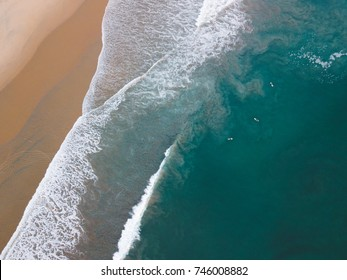 Surfers and waves