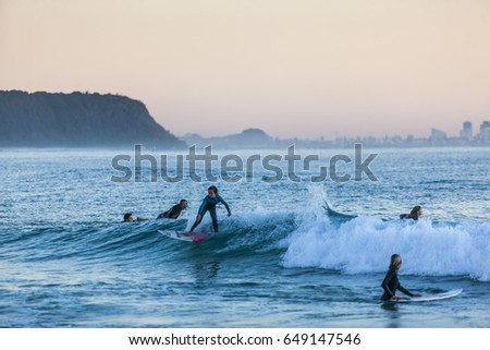 SURFERS,CURRUMBIN ALLEY,AUSTRALIA-2ND JULY 2015:-Surfing is a popular sport and pastime in Australia, people rise early to catch a wave before heading off to work.