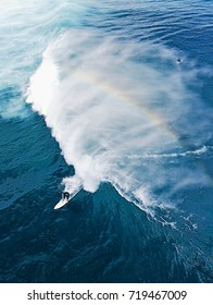 Surfing in Bali. View from above. With rainbow.
